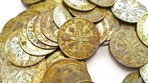 Många guldmynt - Hittade Guldmynt under renoveringen